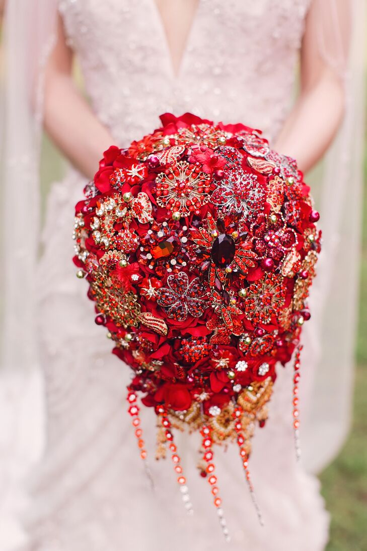 "When Nicole looked at flower options, she didn't feel excited until she stumbled across a sparkly brooch bouquet on Etsy. ""It was full of sparkle and old jewels,"" Nicole says. ""I immediately knew it was the one."""