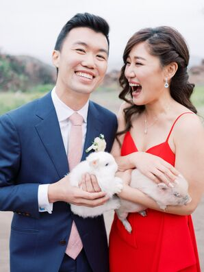 Elegant Couple with Navy Suit, Red Dress and Animals