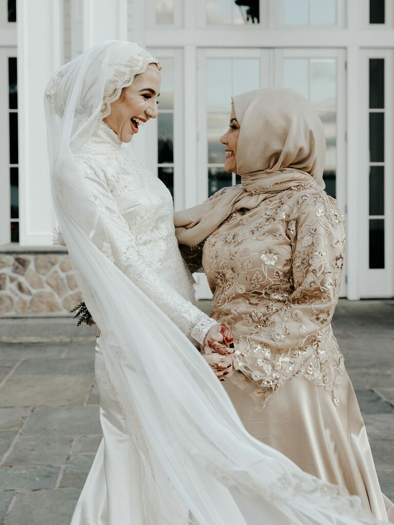 Bride with maid of honor on wedding day