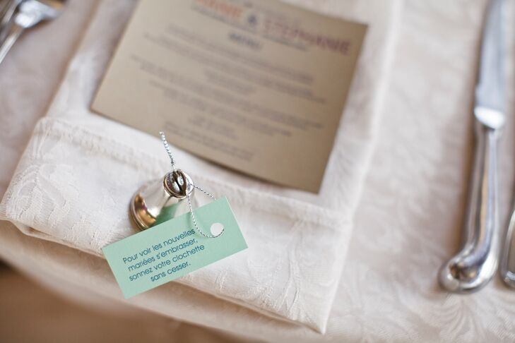 A small silver bell favor was placed at each seat, with a small message in French encouraging guests to ring the bell if they wanted to see the couple kiss.