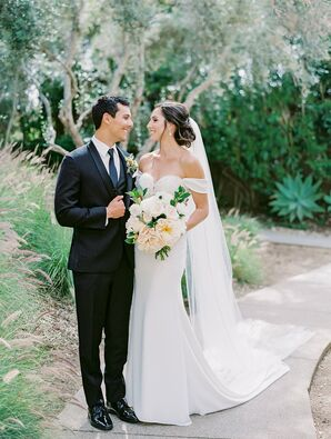 Romantic Couple with Black Tuxedo and Elegant Off-the-Shoulder Dress