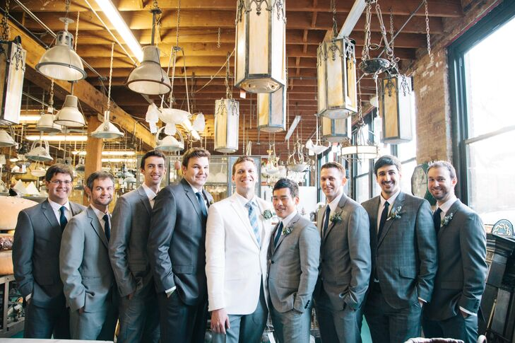 """The groom wore white, which popped against his groomsmen in classic gray suits. """"Rob wanted to wear white and I thought it was a great way to remind people that it's his day, too,"""" Sarah says. """"Plus, it took some of the focus off of me!"""""""
