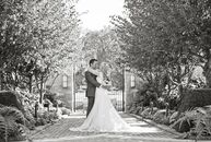 Kristen and Blake chose a vintage, secret garden theme with flowers inspired by traditional English gardens. A color palette of slate gray, plum and b