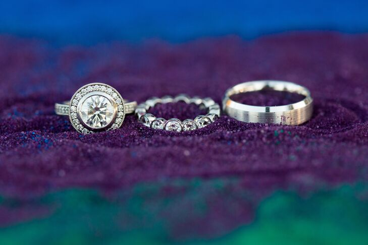 Eric proposed with a gorgeous, halo-set diamond ring. Jennifer chose an eternity-style wedding band, while Eric's band was a simple brushed style.