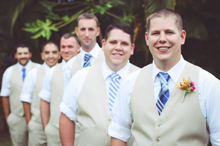 According to Dana, Steven always wears his naval uniform with the sleeves rolled up, so the groomsmen paid tribute to this by rolling up their shirtsleeves (they decided against jackets in the warm weather). They all wore matching beige vests with brown shoes and mismatched, striped, royal blue ties.