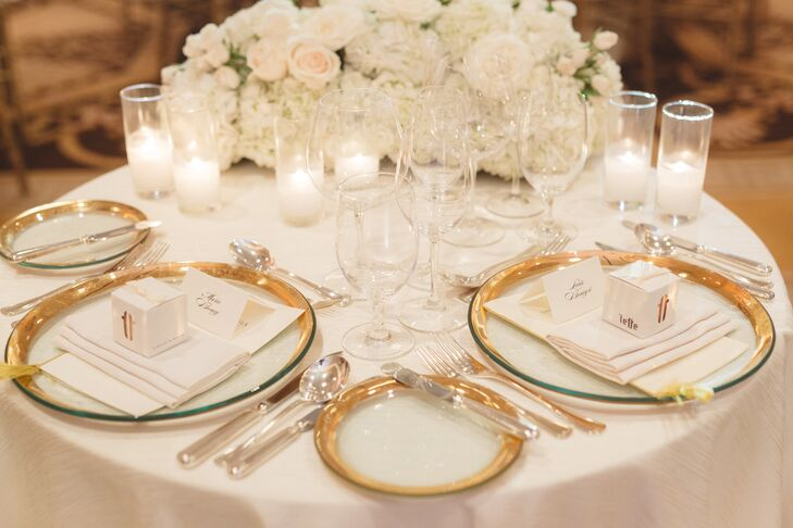 Gold-Rimmed Dinnerware and Romantic Ivory Centerpiece