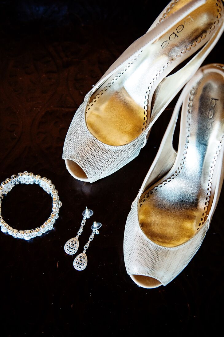 """Instead of buying a new pair of shoes for her wedding, Crystal wore an old pair of Bebe lace heels she bought several years before. """"I wanted to have some shoes that were worn-in so I could dance the night away,"""" she says."""