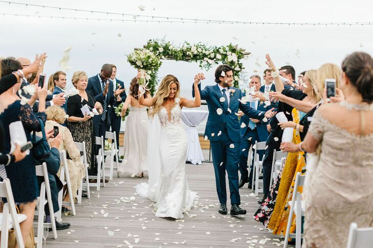 Elegant Beachside Recessional with Tossed Petals
