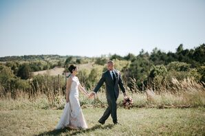 Bride and Groom Stroll Through Rustic Winery