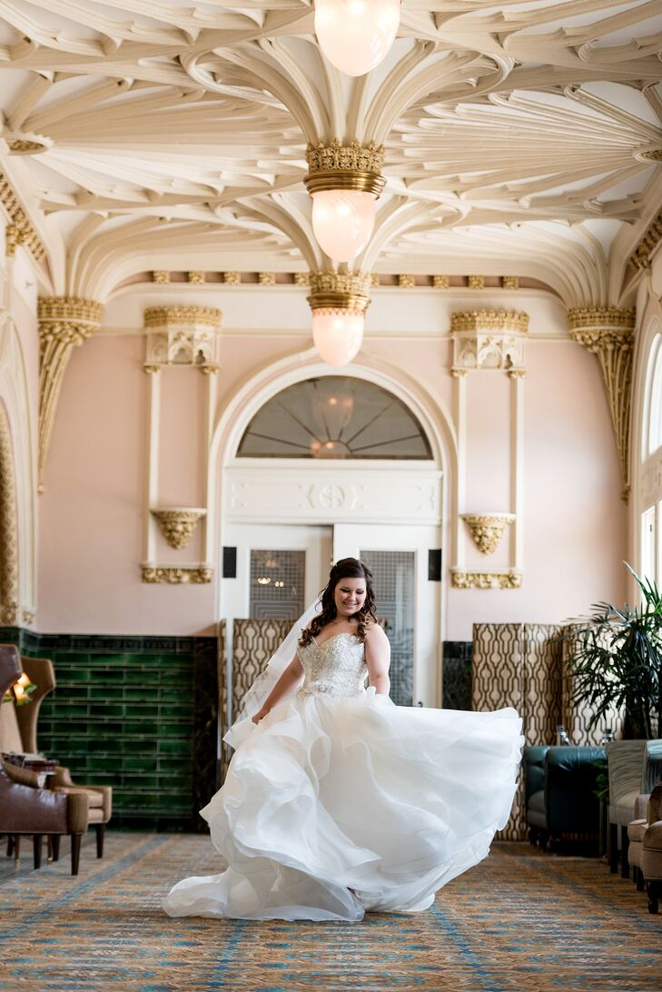 """As soon as I put on that dress, I knew it was the one,"" Amanda says. She describes the ivory princess gown with a horsehair braid skirt and layers of tulle as ""a piece of art in itself."" She customized the look with a belt, coordinated the veil and shoes with the skirt and kept her jewelry minimal and simple."