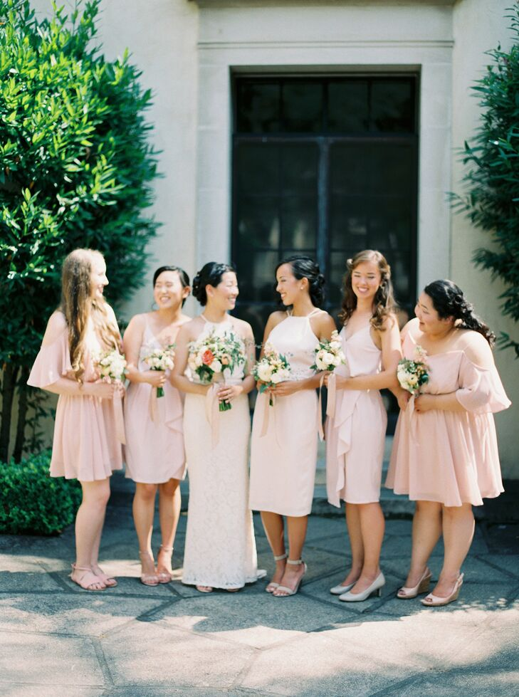 Alison's bridemaids wore simple knee-length blush dresses in different styles—a perfect fit for the relaxed, naturally beautiful setting.