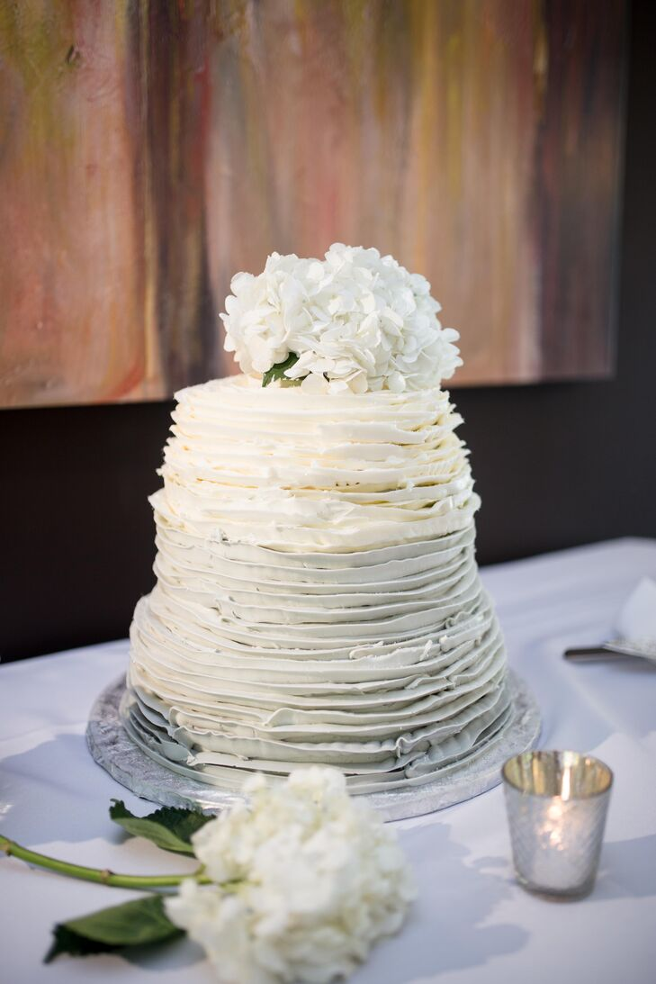 """Snickerdoodles Bakery of Hampstead, Maryland, designed Mandy and Jesse's wedding cake, which had a white ombre design and cannoli flavor. """"The most beautiful, straight-off-a-wedding-magazine-cover, decadent and delicious cake ever,"""" Mandy says."""