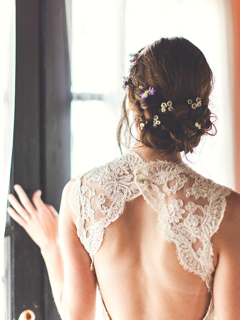 Messy updo wedding hairstyle with flowers