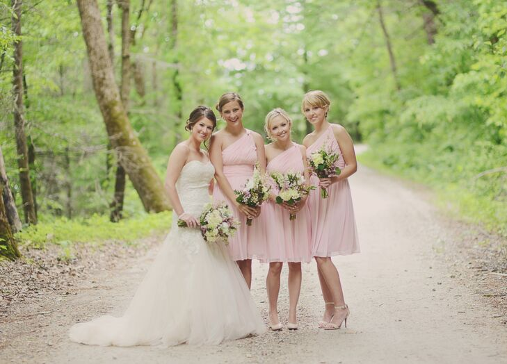 The bridesmaids wore a pink chiffon, one-shoulder dress.