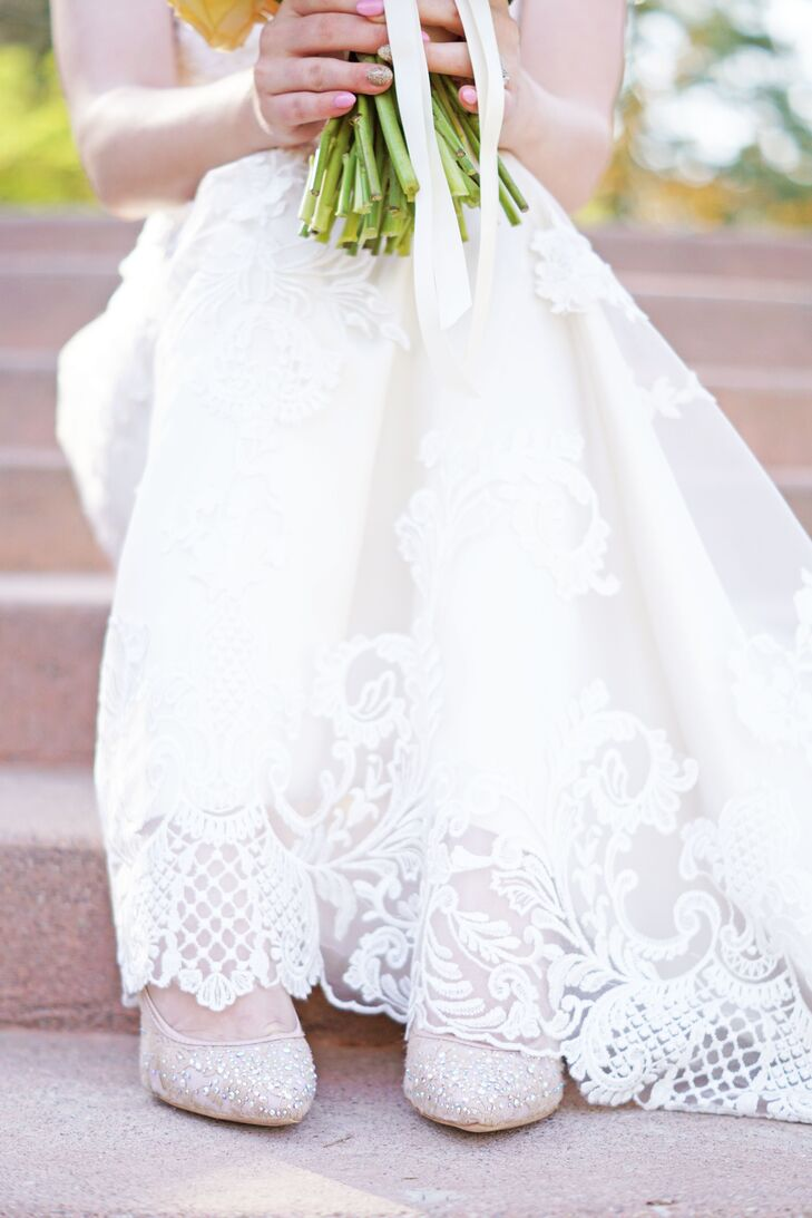 As a glam addition to her bridal look, Ashlee wore neutral pointed-toe shoes with crystal embellishments all over the subtly patterned fabric.