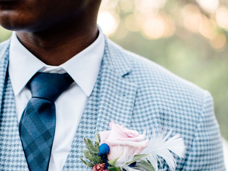 Groom wearing plaid blue tie