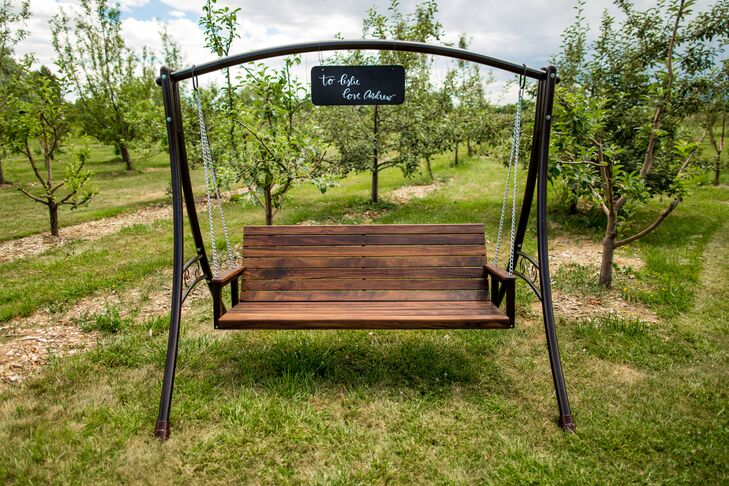 """Instead of a traditional wedding gift, Andrew made this gorgeous wooden swing for Leslie. """"It was so neat to receive it at the wedding where our guests could admire his handiwork,"""" Leslie says. """"He loves me and showers me with beautiful handmade gifts."""""""