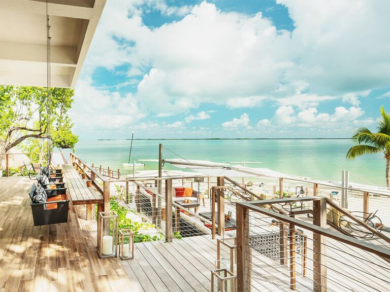Private beachfront deck with swings at Baker's Cay Resort in Key Largo