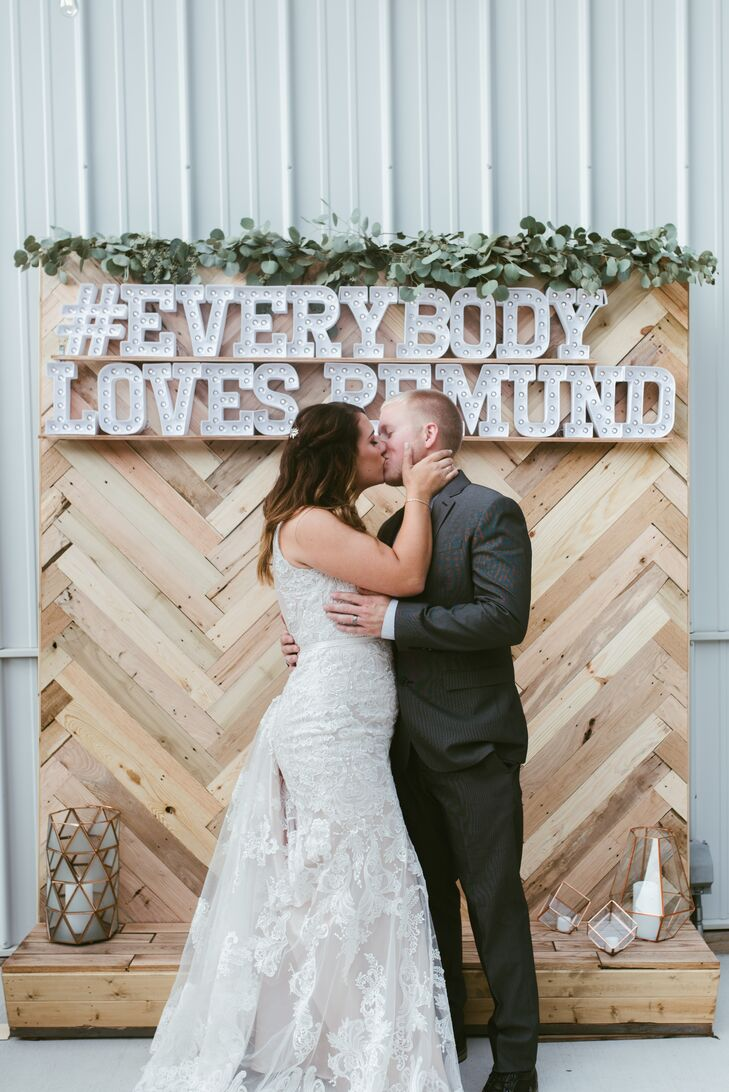 """We wanted every detail to be a reflection on our love or our personal style,"" Trisha says. ""My favorite details were the ones that have such meaning in our hearts."" These included the wedding hashtag #EverybodyLovesRemund, a phrase Trisha used to write on signs to cheer Nic on at sports games in high school."