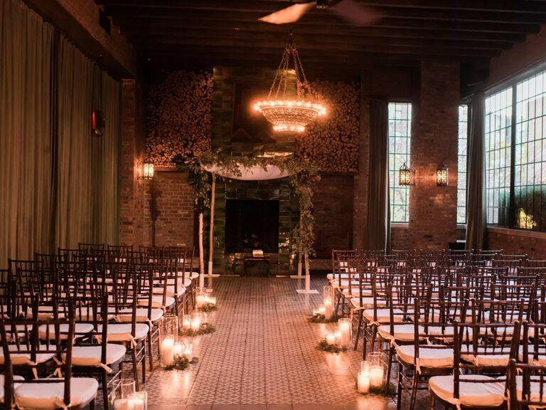 winter wedding ideas candle lined aisle