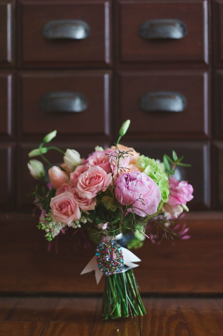 The bride carried a bouquet of roses and peonies down the aisle.