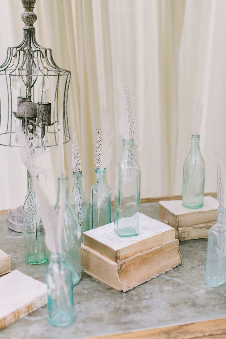 "To bring their vintage theme to life, Stefanie and Christopher added details throughout Lord Thompson Manor, including vintage glass bottles, old books, spectacles and clocks. ""On our first visit to Thompson Manor, Jackie—the owner and wedding planner—showed us an entire room of decor she uses; it was like being in a beautiful antique store. I love antiquing, so I was in heaven,"" Stefanie says."