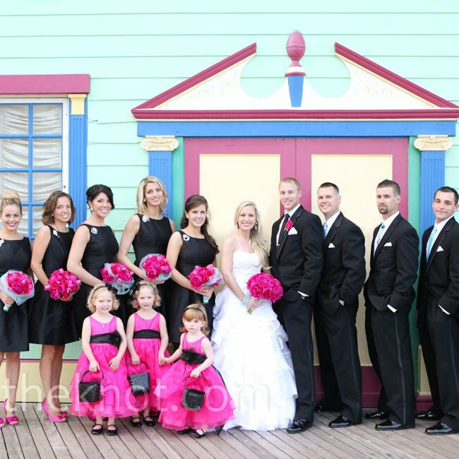 The bridesmaids wore black cocktail dresses with bright pink heels, while the groomsmen coordinated with the color palette in black tuxes and aqua ties.