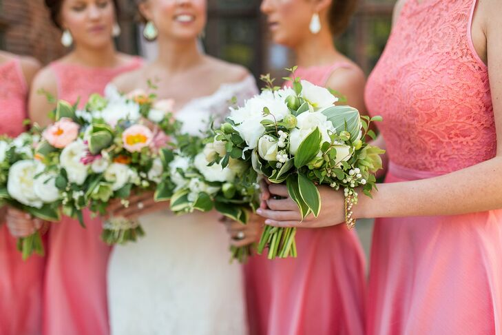 Liz's bridesmaids carried ivory and green bouquets with peonies, lilies of the valley and greenery.