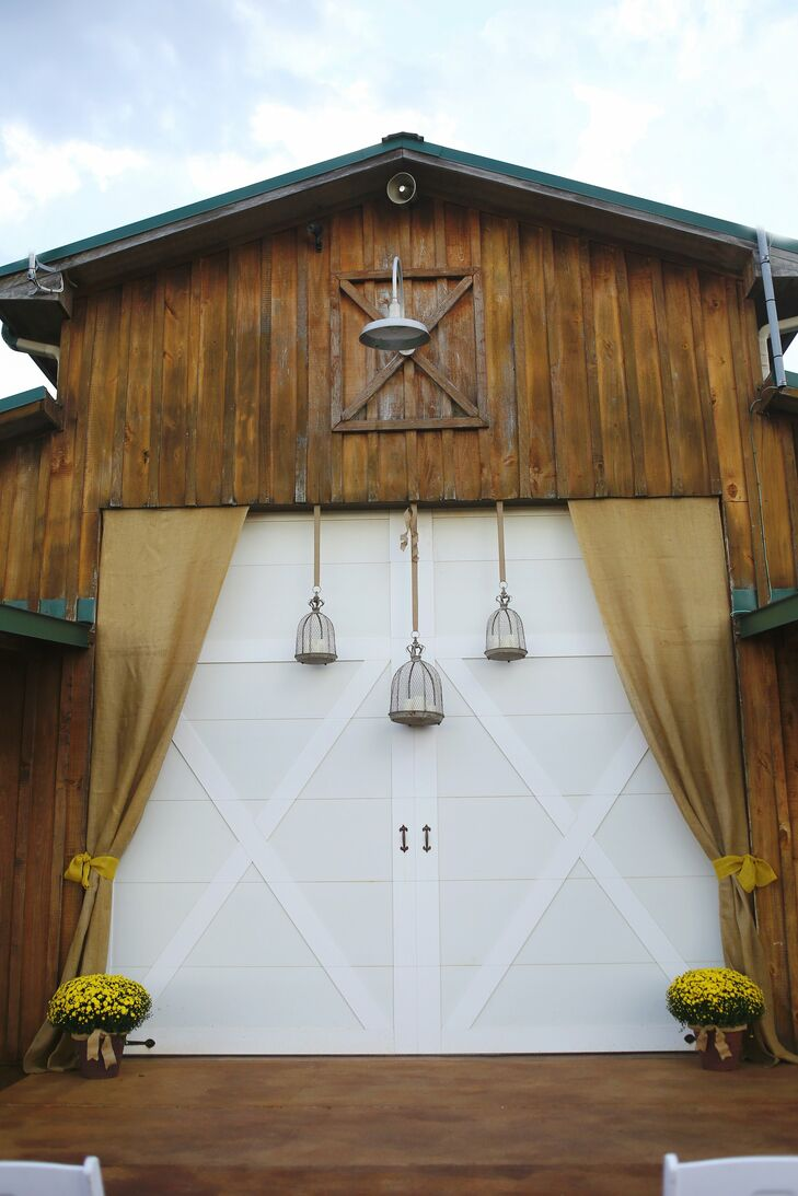 Barn Ceremony Backdrop with Hanging Lanterns