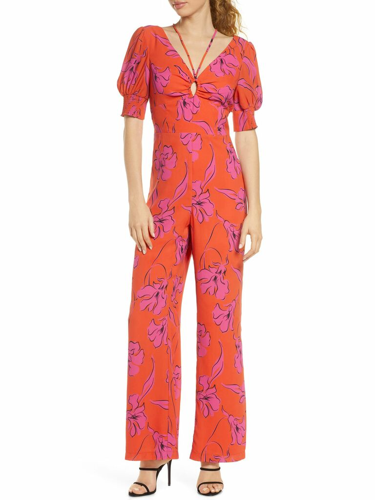 poppy print magenta jumpsuit with puff sleeves