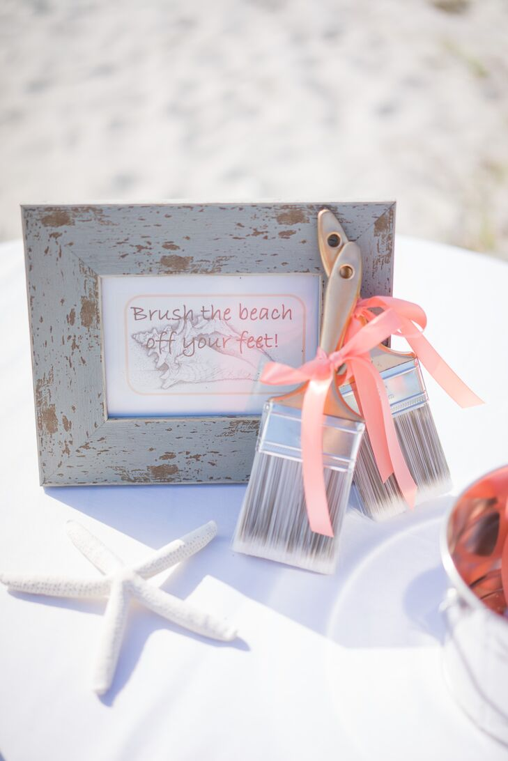 Of course, no beach wedding is complete without a few seashells. Starfish and conch shells were present in a few parts of their stationery, including a sweet sign for guests to dust the sand off their feet from the beach ceremony at at 'Tween Waters Inn Island Resort in Captiva Island, Florida.