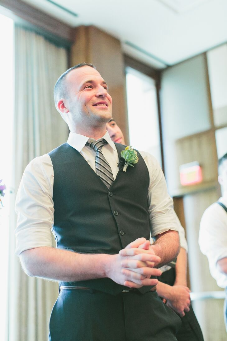 Seth rocked a classic look with his black and charcoal gray-striped tie, tucked underneath his charcoal gray vest pinned with a succulent and craspedia boutonniere.