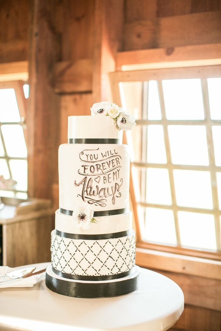 """Italia and Andy's custom cake was a combination of buttercream and fondant, with layers with chocolate peanut butter and vanilla. The words """"You Will Forever Be My Always"""" were inscribed on the middle tier."""