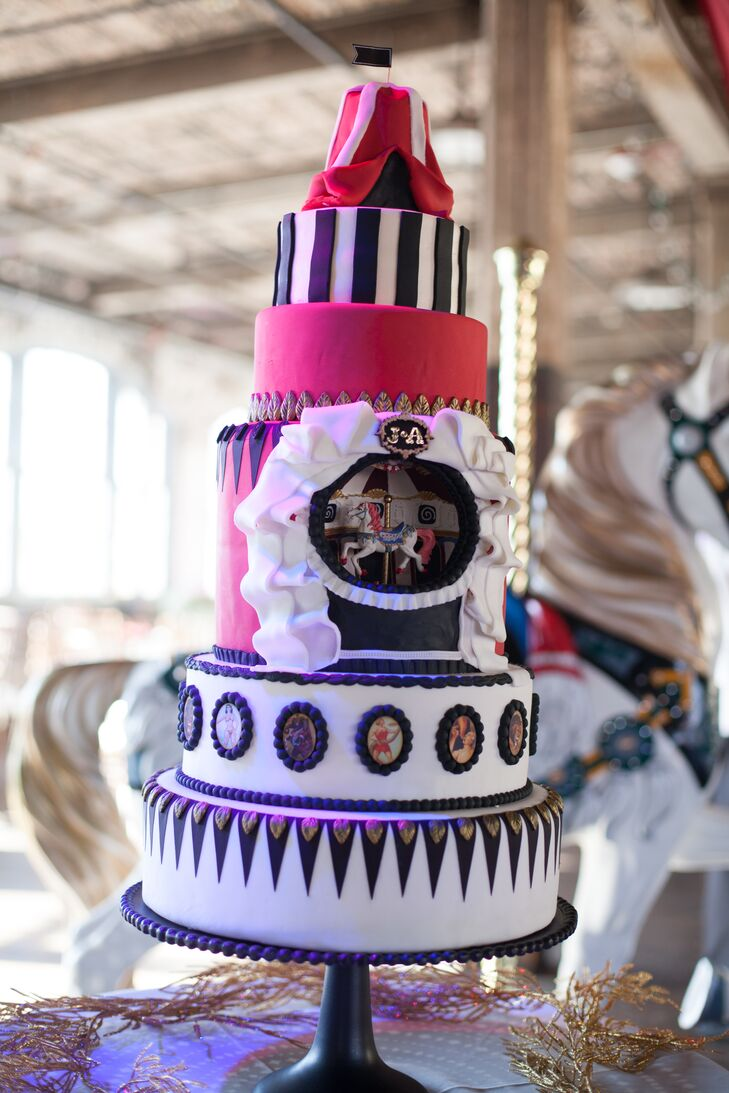 """Ashley found the inspiration for her circus-themed wedding cake on Pinterest and took it one step further by choosing to create the entire cake by hand. Black and white fondant flags covered the base of the cake, while vintage portraits of circus performers added a fun touch. But nothing was more wow-worthy than the hollowed-out tier that contained a carousel horse music box. """"I was browsing on eBay for props and came across the box,"""" Ashley explains. """"It was the perfect touch and definitely made the cake one-of-a-kind."""""""