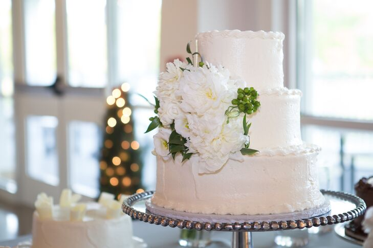 The three-tier white cake was decorated with fresh white flowers.