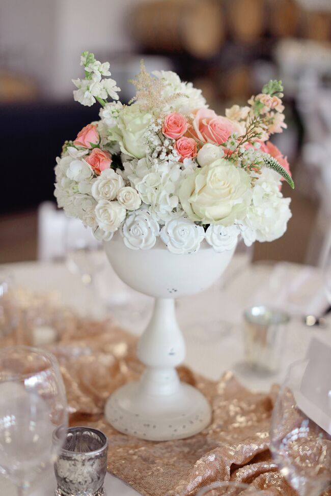 Flower arrangements of roses and stock with touches of astilbes, baby's breath and veronica decorated each dining table.