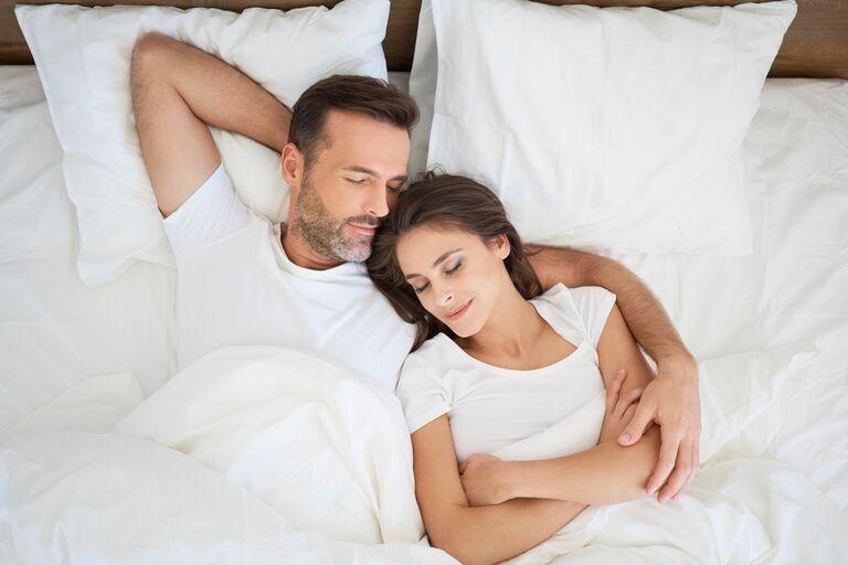 couple sleeping wellness wedding