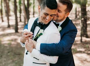 Derrick and Garrett Walker paired a palette of pale blue and navy with a tree house venue and enchanting extras to give their early-summer wedding a p