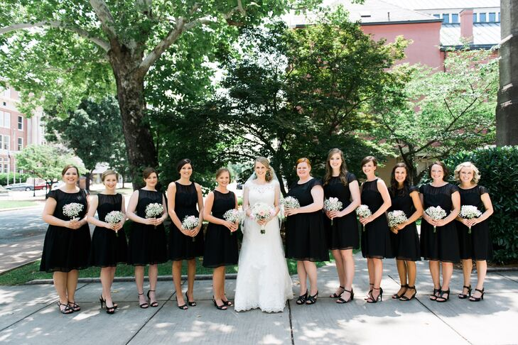 """""""I wanted an elegant and classy style for the wedding, and black and white always conveys that to me,"""" Ginnie says. To accomplish her vision, her bridesmaids wore short black dresses and carried bouquets of baby's breath and blush roses."""
