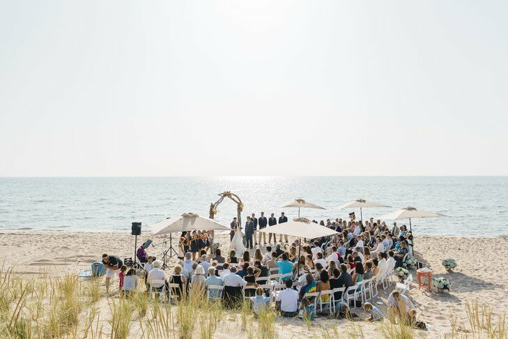 Bride and groom getting married in their back yard, which happens to be a beach in Michigan
