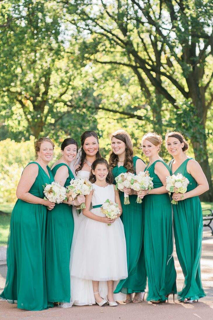 """I knew I wanted deep emerald green in a flowy fabric for my bridesmaids, and I wanted all of the girls to pick their own style from the same designer,"" Erin says. ""But when all the bridesmaids picked the same style, I didn't argue. They looked amazing!"""