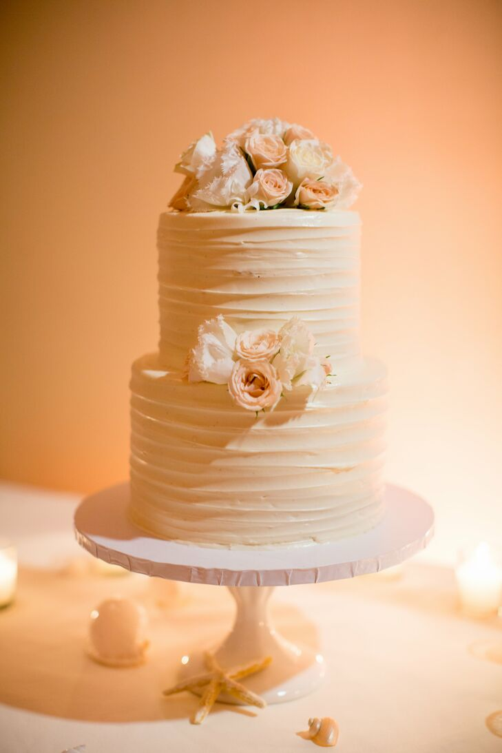 For dessert, guests were served a trio sampler with chocolate mousse fudge torte, caramel cheesecake creme brulee, and lemon chiffon torte. There was also a two tier red velvet cake with cream cheese icing. The cake was decorated with flowers that matched the table arrangements.