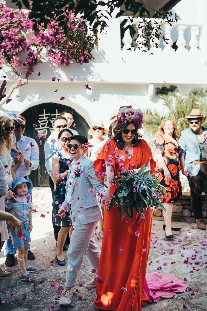 Couple Recessing Amid Cascade of Rose Petals in Menorca, Spain