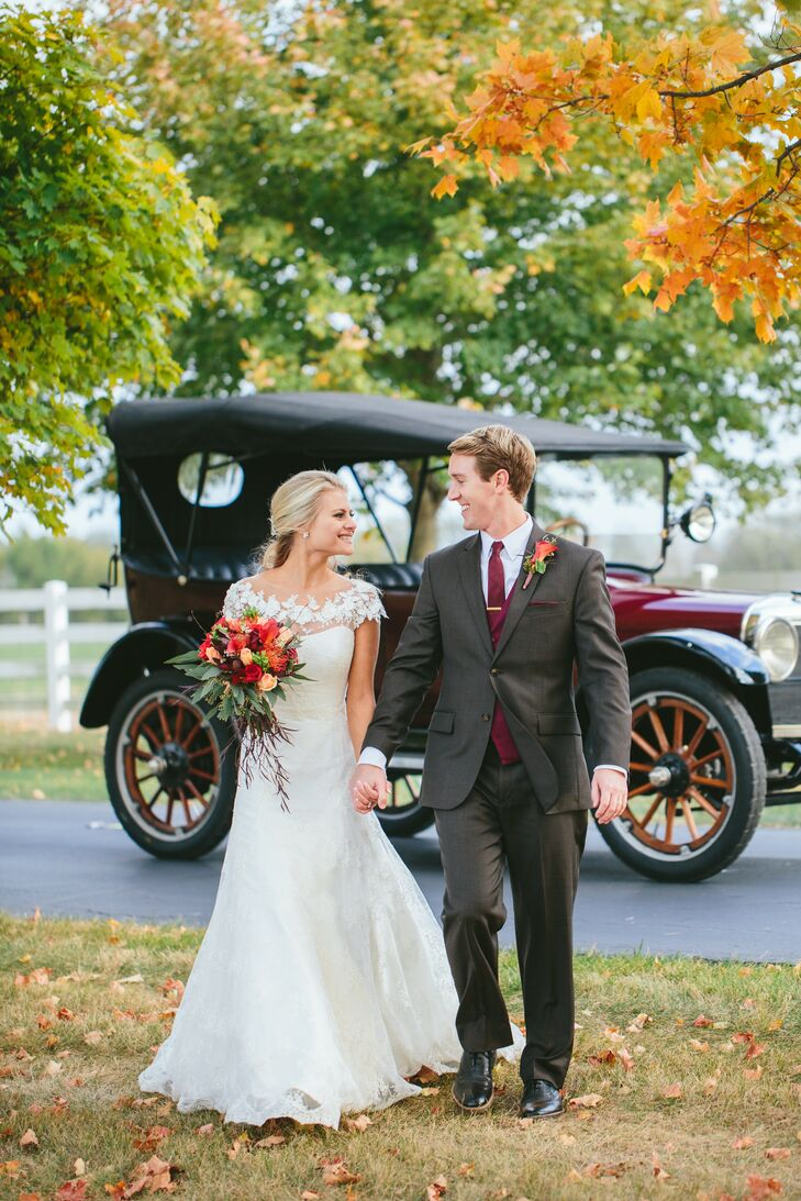 After the ceremony, Gail and Adam rode a vintage car around the Darby House grounds and paused to take photos amid the fall foliage.