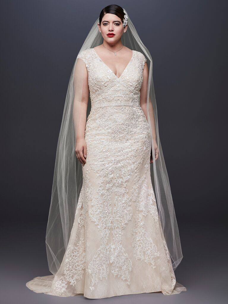 e85faf3b9e74 Oleg Cassini at David's Bridal Spring 2019 lacy, embroidered wedding gown  with a plunging neckline
