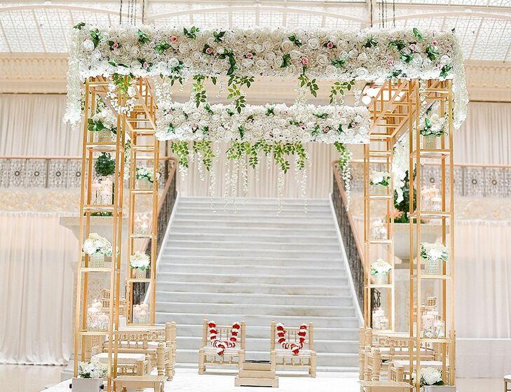 Glamorous Mandap with Gold Pillars, White Roses and Greenery