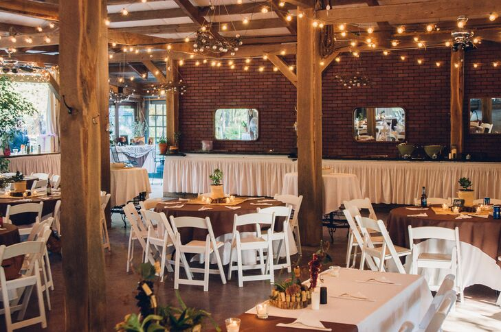 """We loved the reception area, which was just a few steps away from the amphitheater,"" Laura says. ""Inside was natural wood beams, which provided a rustic feel, decorated with white sails and hanging grape vine chandeliers."""