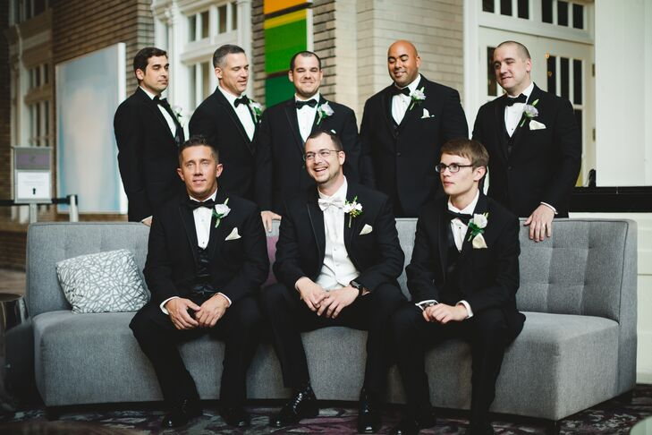The groomsmen looked dapper in black Calvin Klein two-button tuxedos that they accessorized with black vests and bow ties.