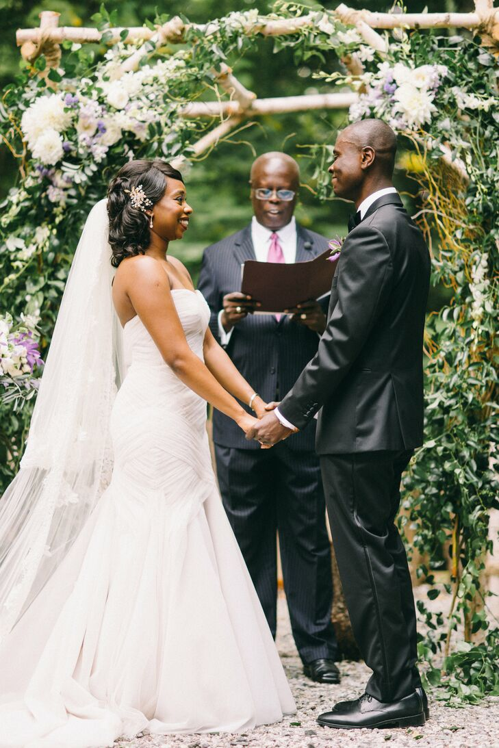 Outdoor Ceremony in front of Greenery-Covered Altar