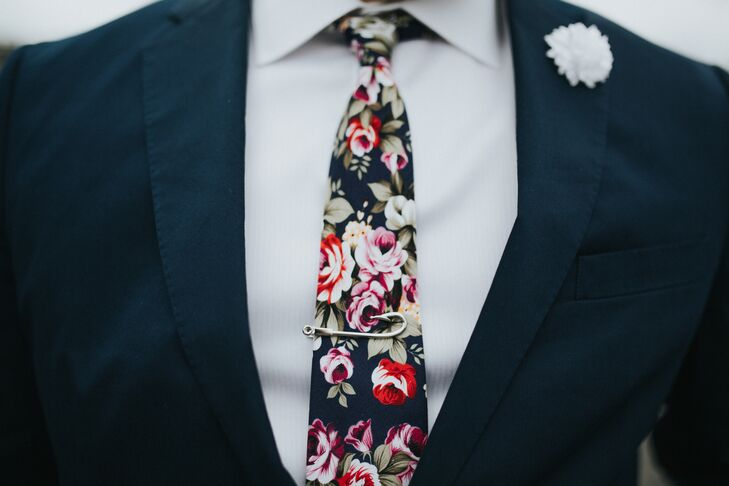 Justin's personality shined through in his colorful floral tie and fish hook tie clip.